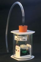 Space tube with piezo sounder in clear acrylic tube alternative to bell in a vacuum demonstration